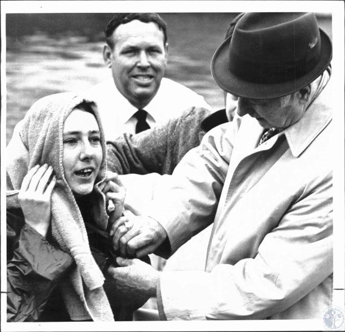 "Elizabeth ""Little Bit"" Shields, Rev. Claude Ely and Richard Quehl Deputy Sheriff (Baptism) December 9, 1971."